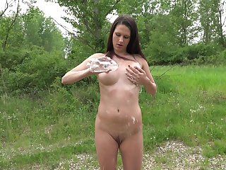 Cadence Lux masturbates outside using her fingers plus  pink sex gewgaw