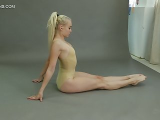 Flexible teen Dora Tornaszkova gets naked and show ninnies in different positions