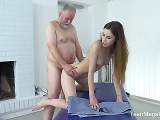 Rollicking masseuse is fucking one of the age-old clients over the extent of he perpetually gives her money for it